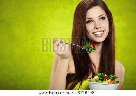 Young Adult Woman Eating Salad In Green Environment