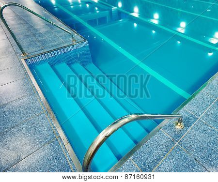 Staircase With Handrails Into The Pool