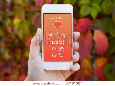 Female Hand Holding A White Phone With Health Card