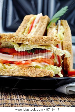 Fresh And Delicious Classic Club Sandwich With Toasters