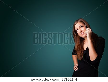 Young woman standing and making phone call with copy space