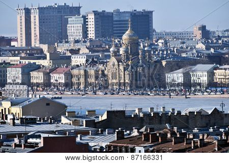 ST. PETERSBURG, RUSSIA - MARCH 5, 2015: View to Neva river and the Assumption Church on the Vasilievsky island. Church was built in 1985-1897, and is a cultural heritage of Russia