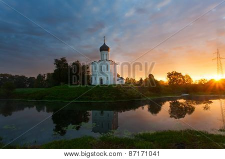 Beautiful Sunrise Over Church Of The Intercession Of The Holy Virgin On Nerl River, Bogolyubovo, Rus