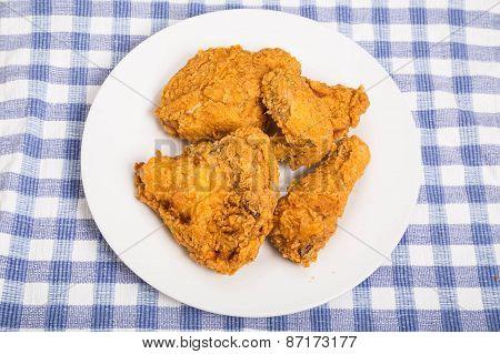 Half Fried Chicken On White Plate