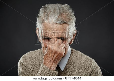Old Man With Migraine