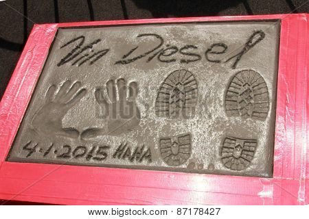LOS ANGELES - APR 1:  Vin Diesel Hand and Foot Prints, with thumbprints of his two older children at the Vin Diesel Print Ceremony at the TCL Chinese Theater on April 1, 2015 in Los Angeles, CA