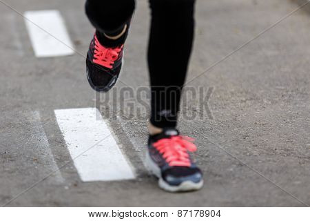 Sports Background. Runner Feet Running On Road Closeup On Shoe.