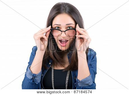Surprised Girl Looking Over Glasses