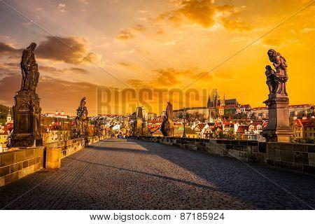Charles bridge with statues and Prague castle on surise. Prague, Czech Republic