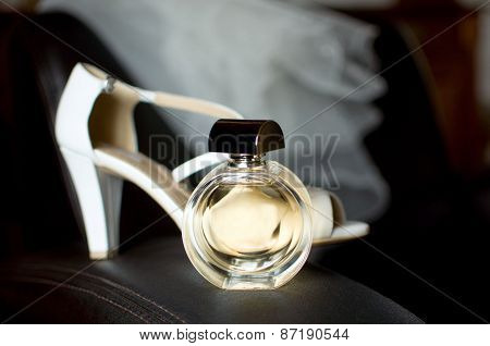 Bride's Veil With Shoes And Parfume On Leather Armchair