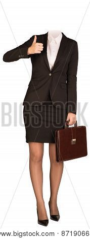 Businesswoman in suit without head, holding briefcase and showing thumb-up. Isolated