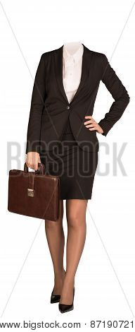 Businesswoman in suit without head, standing and holding briefcase. Isolated