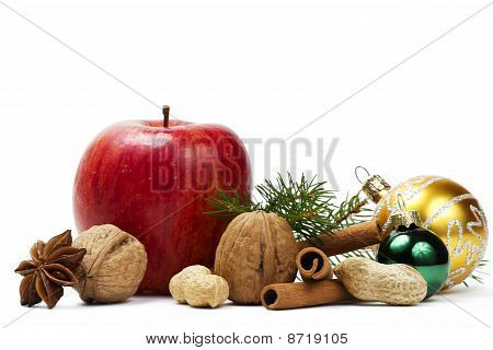 apple anise nuts christmas balls and a branch