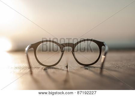 glasses lying on a wooden table front view sundawn