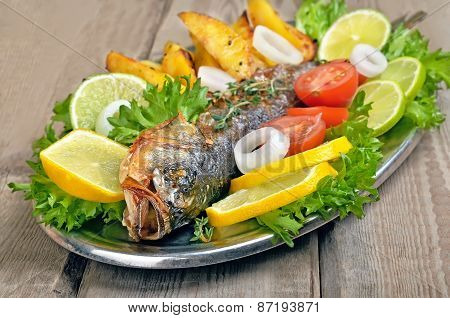 Baked Fish On Rustic Table