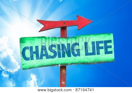 Chasing Life sign with sky background
