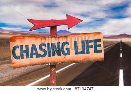 Chasing Life sign with road background