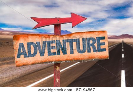 Adventure sign with road background