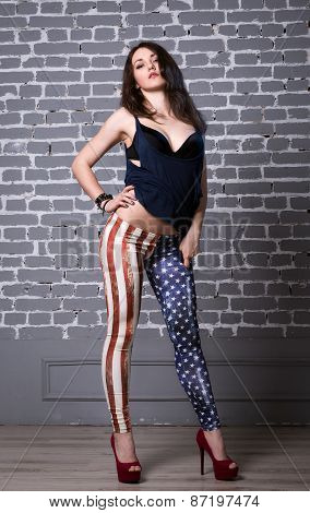 Beautiful Girl In Dark Blue Shirt In Black Bra In American Flag Pants With Black Hair Posing.