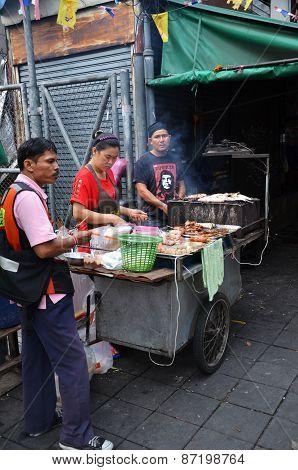 An Unidentified Street Vendor Cooks At A Roadside Restaurant In Bangkok, Thailand.