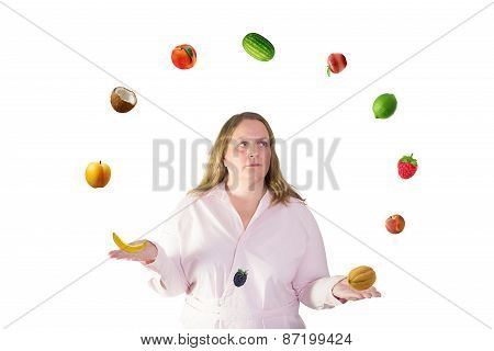 Woman juggles with fruit
