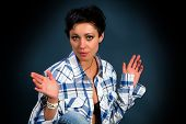 picture of redneck  - beautiful young girl in a plaid shirt on a dark background - JPG