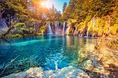 Majestic view on turquoise water and sunny beams in the Plitvice Lakes National Park. Croatia. Europ poster