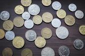 pic of copper coins  - Various eurpean coins collection on old wooden table - JPG