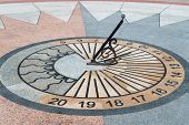 stock photo of sundial  - Sundial lined with marble mosaic showing the time - JPG