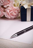 stock photo of blue rose  - blank card with pen - JPG