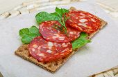 stock photo of salami  - Salami sandwich with dill and salat leaves - JPG