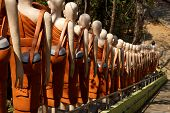 pic of stairway  - Statues of Buddhist nuns line the stairway at Sambuk Mountain Monastery Kratie Cambodia - JPG