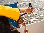 stock photo of yachts  - Male hand on winch capstan with rope on sailing boat - JPG