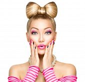 stock photo of woman  - Beauty surprised fashion model girl with funny bow hairstyle - JPG