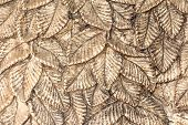 foto of carving  - Silver metal surface with carved leaves many leaves - JPG