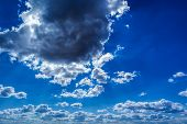 image of cumulus-clouds  - The rays of the Sun - JPG