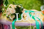 pic of floral bouquet  - Word Love and wedding bouquet of flowers on a romantic floral swing as a Valentine