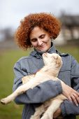 image of baby goat  - Farmer woman holding a cute baby goat outdoor - JPG