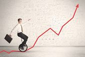 picture of unicycle  - Business parson riding unicycle on an uprising red arrow concept - JPG