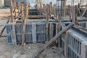foto of concrete pouring  - construction house reinforcement metal framework for concrete pouring - JPG