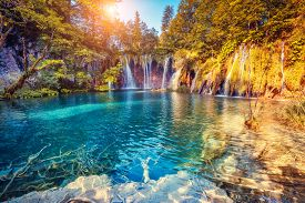 picture of sunny season  - Majestic view on turquoise water and sunny beams in the Plitvice Lakes National Park - JPG