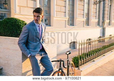 Handsome businessman standing outdoors in town