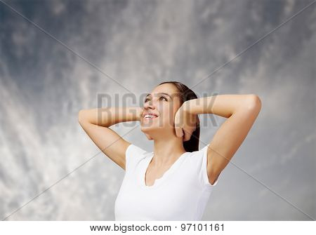 Young pretty woman closing ears with hands