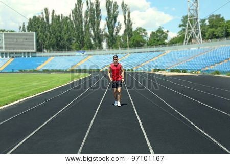 Young man jogging on stadium