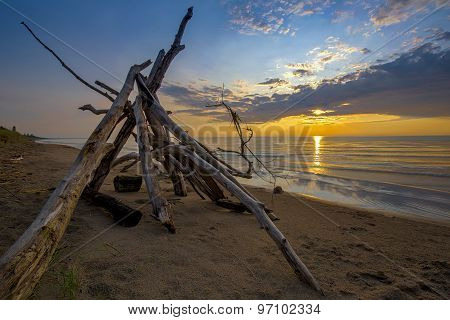 Lean-to On A Lake Huron Beach As The Sun Sets