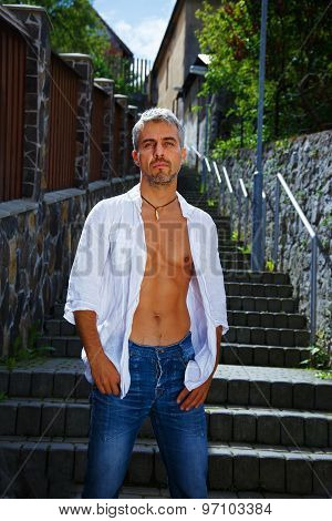 Sexy Fashion Portrait Hot Male Model In Stylish Jeans And Shirt With Muscular Body Posing. Wolves To