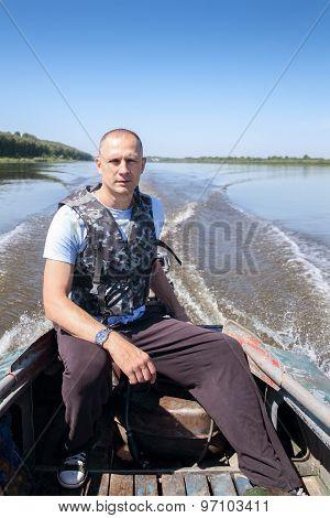 fisherman on  boat moves in  river