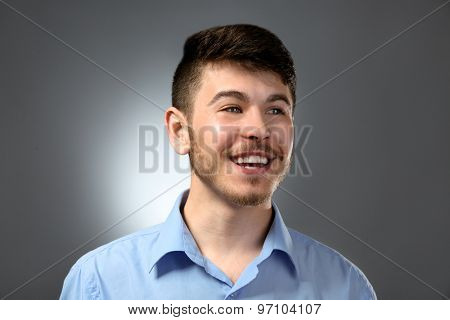 Portrait of smiling man on gray background