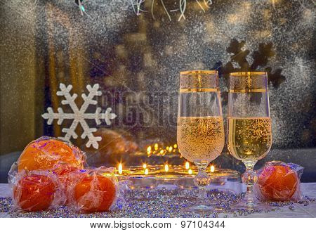 Glasses Of Champagne And Mandarin Against The Window. Photo In Old Image Style.