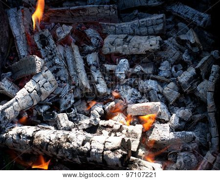 Burning charcoal embers firewood with ashes and flames